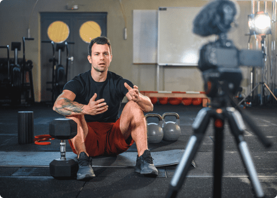 A man sitting on floor with dumbbells