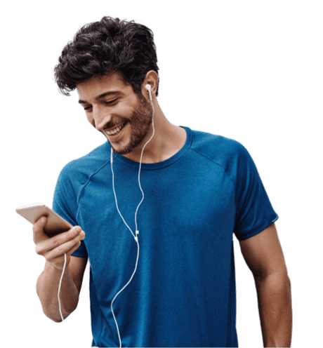 A man with earphones looking into his mobile