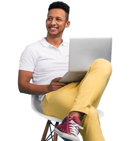 Man in casuals sitting on a chair with his laptop