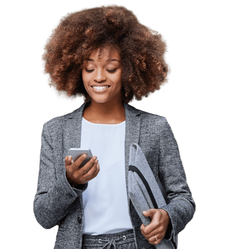 A happy woman looking at mobile in grey coat