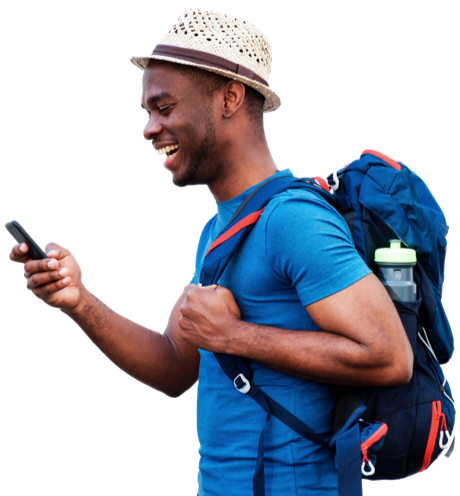 man with backpack checking phone