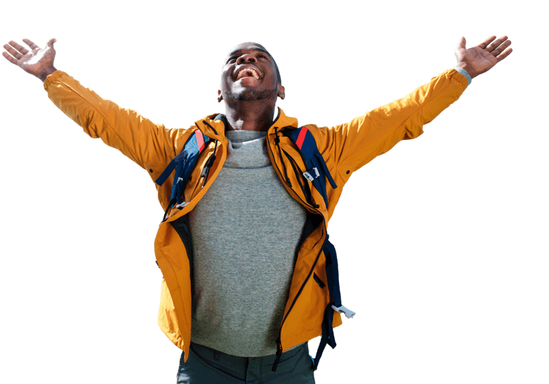 A man in yellow jacket with hands up