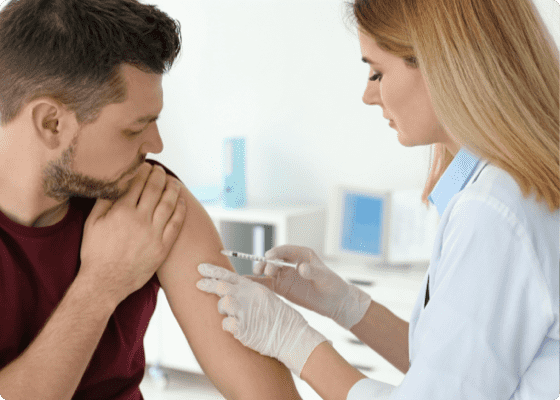 doctor vaccinating a patient