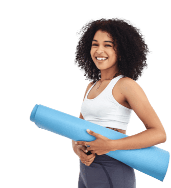 Happy woman standing with yoga mat