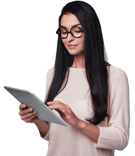 A woman in spectacles holding a tablet in her hand