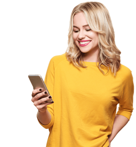 Smiling woman in yellow top looking at her mobile