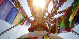 DCL/size1200x628/Flags_on_stupa_590x292.jpg