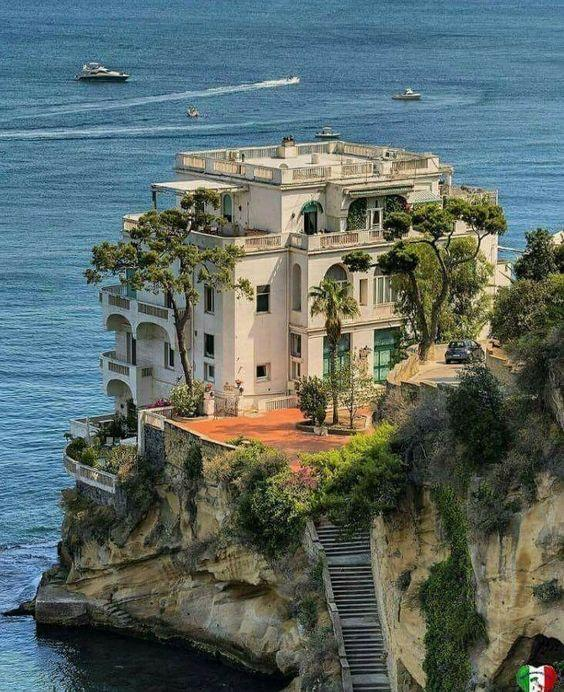 Amazing Hotel on the edge of a cliff overlooking the ocean by crenk