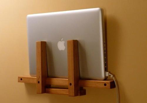 macbook stand next to sofa or bed by crenk