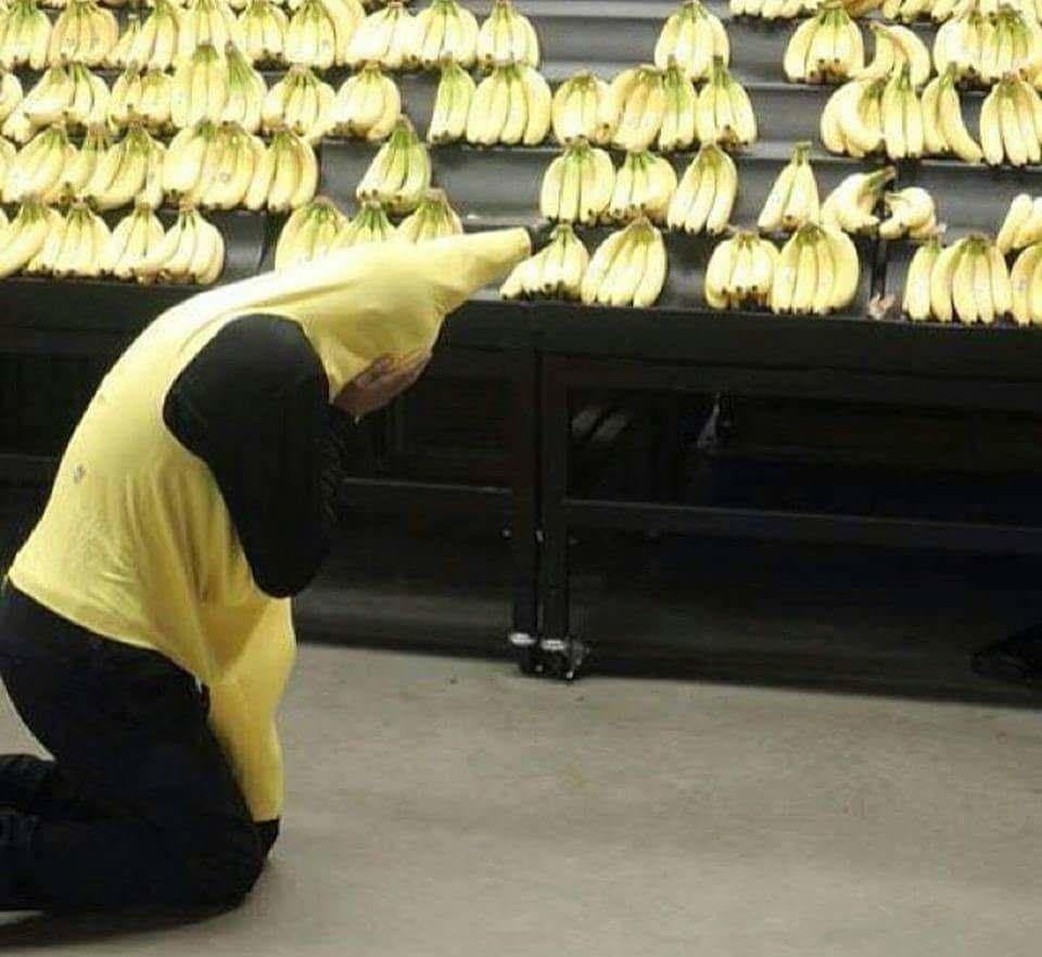 Man Dressed as a Banana who is crying in front of other bananas by crenk