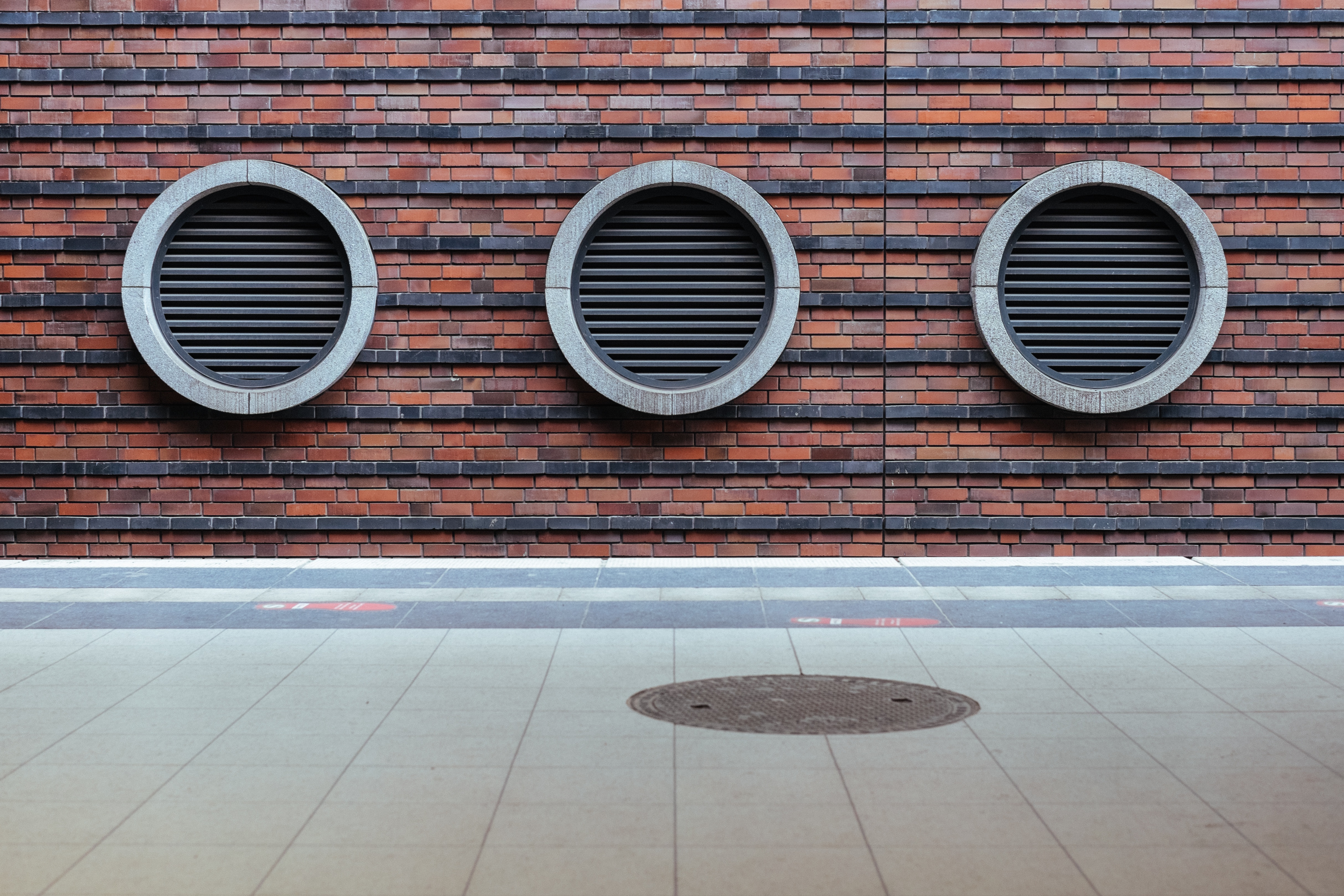 Side of a building with three port holes by crenk