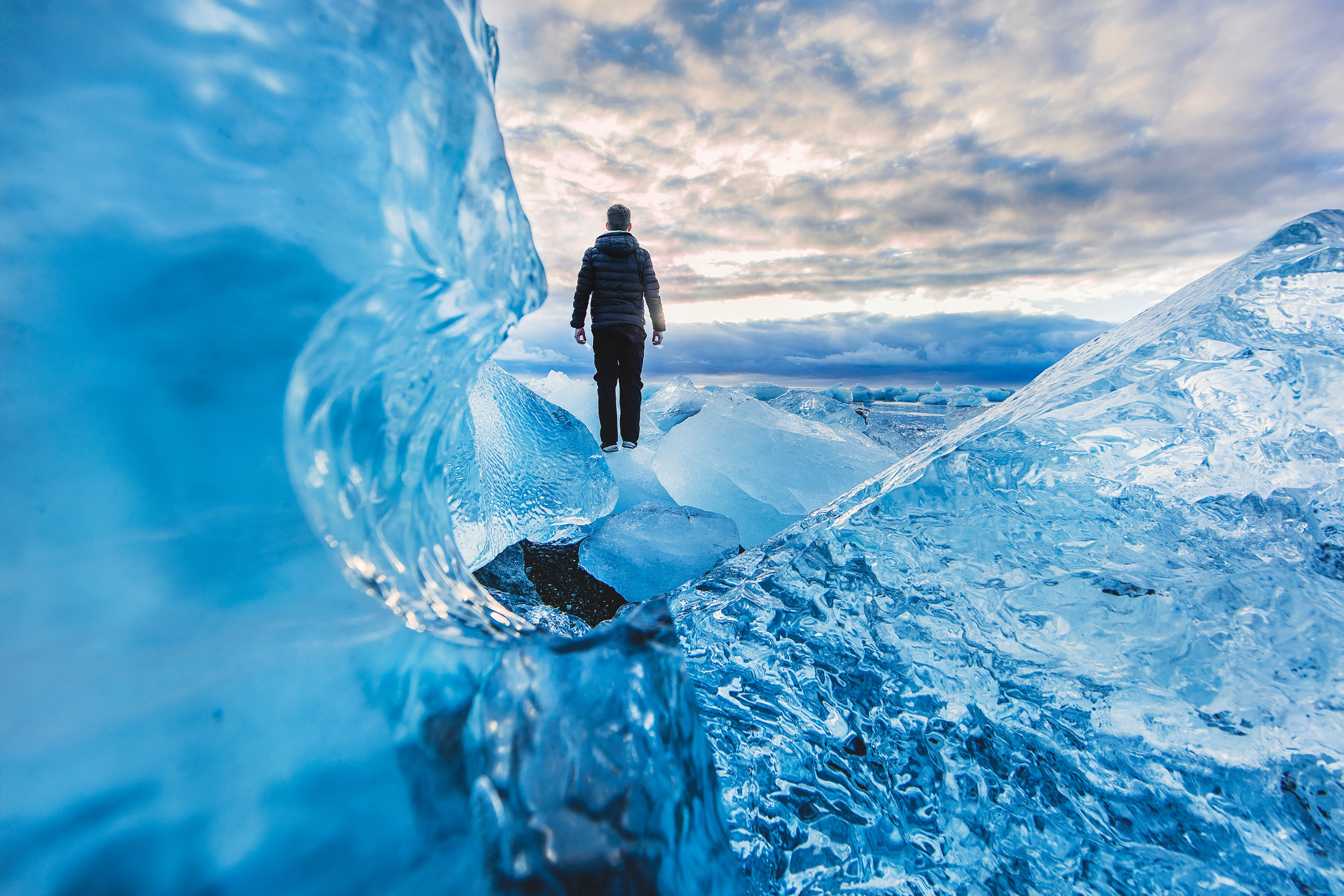 Man standing in the middle of Alaska surrounded by Ice by crenk