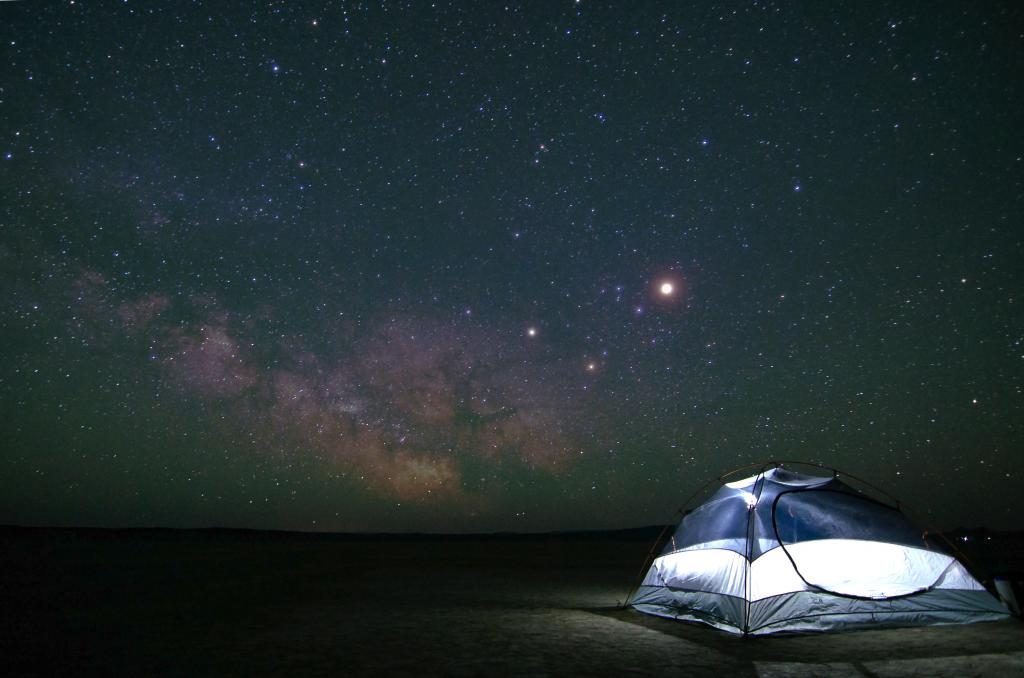 Amazing view of the sky and the stars and a tent by crenk