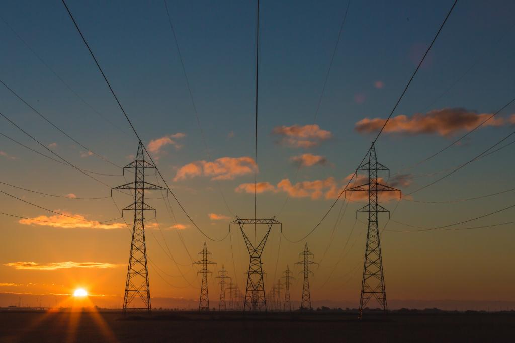 Sunrise on a perfect blue sky with Powerlines by crenk