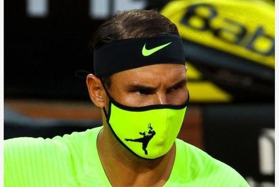 Rafael Nadal at the Italian Open in his special made matching face mask by crenk
