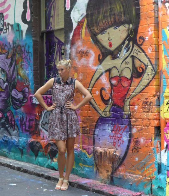 Maria Sharapova Striking a Pose in front of street art by crenk