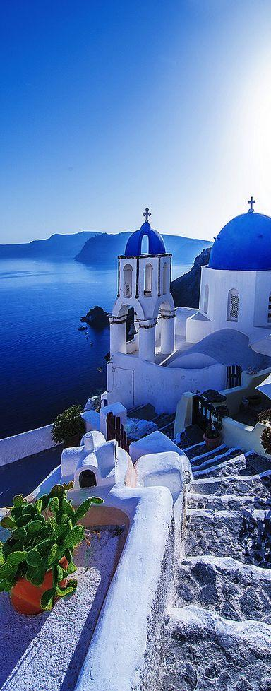 Santorini in Greece guides down from glistening white buildings to sparkling waters! by crenk