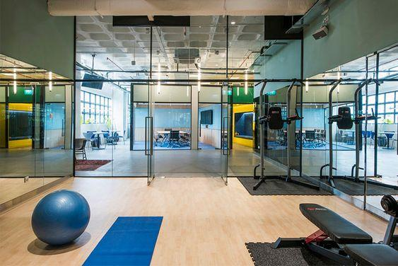 Amazing office gym - glass walls and wooden floors by crenk