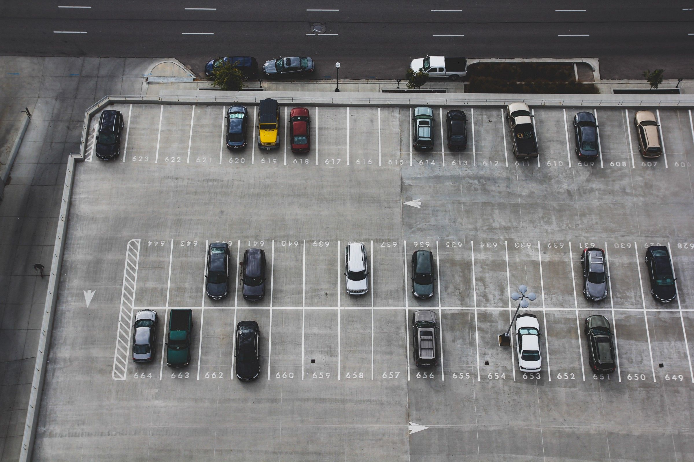 An aerial image of a half-empty parking lot.