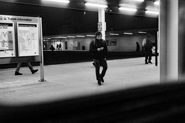 A man waits on a subway platform