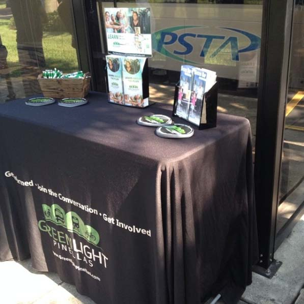 A table with a GreenLight Pinellas logo and brochures