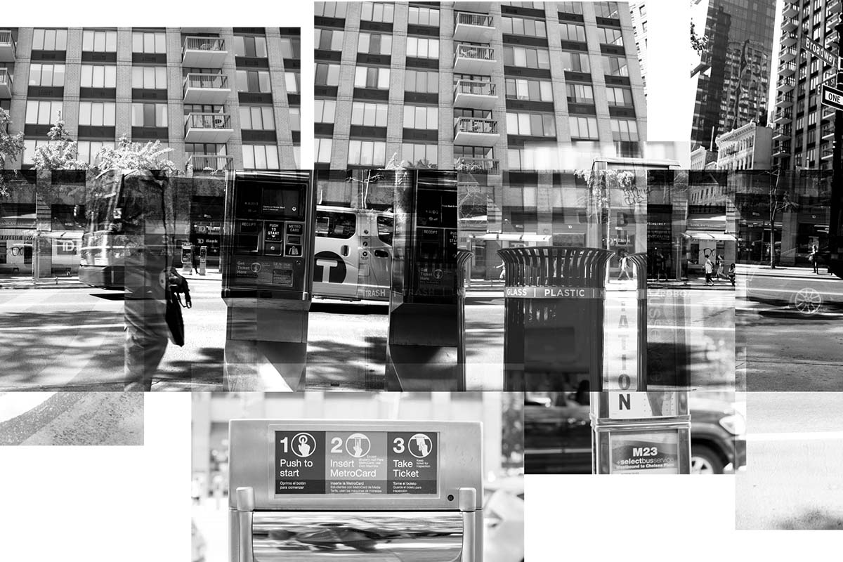 A black and white artistic photo of buildings and sidewalks and curbs