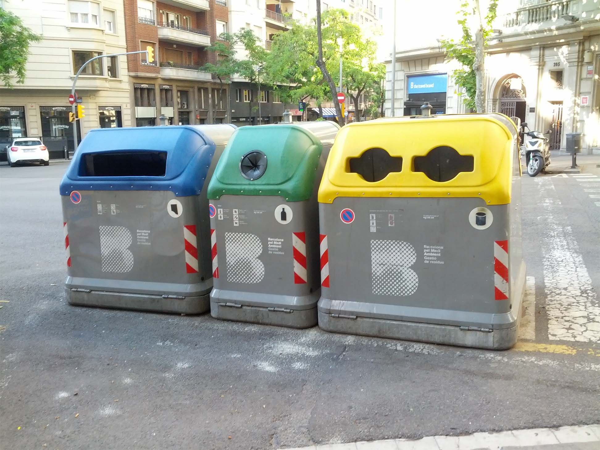 Photo of different-colored trash bins
