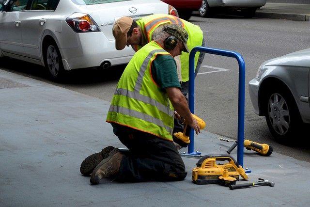 Workers on the sidewalk