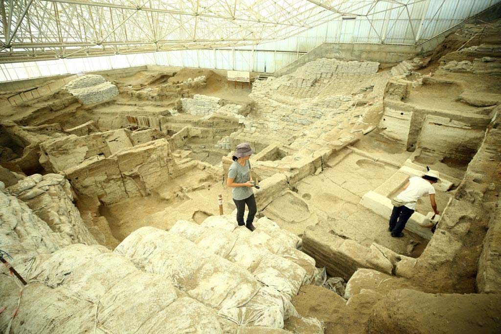 Archaeologists at an excavation site