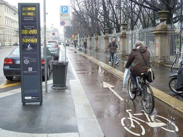 Biker on bike path in the rain with automatic counter