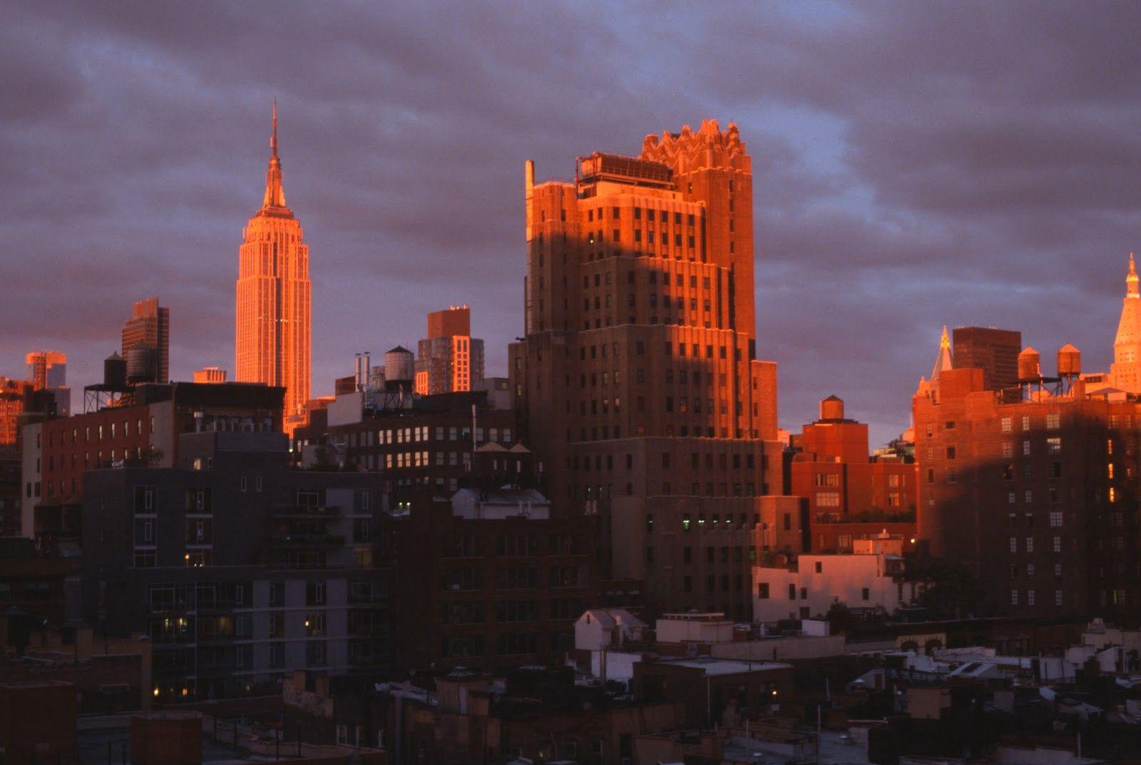 Manhattan skyline casting shadows over streets