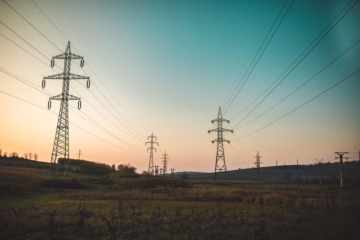Power lines running across a field