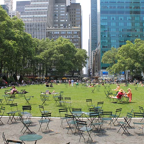 People sitting on chairs in Bryant Park