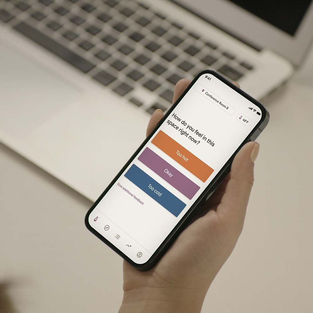 A hand holding an iPhone with the Mesa app