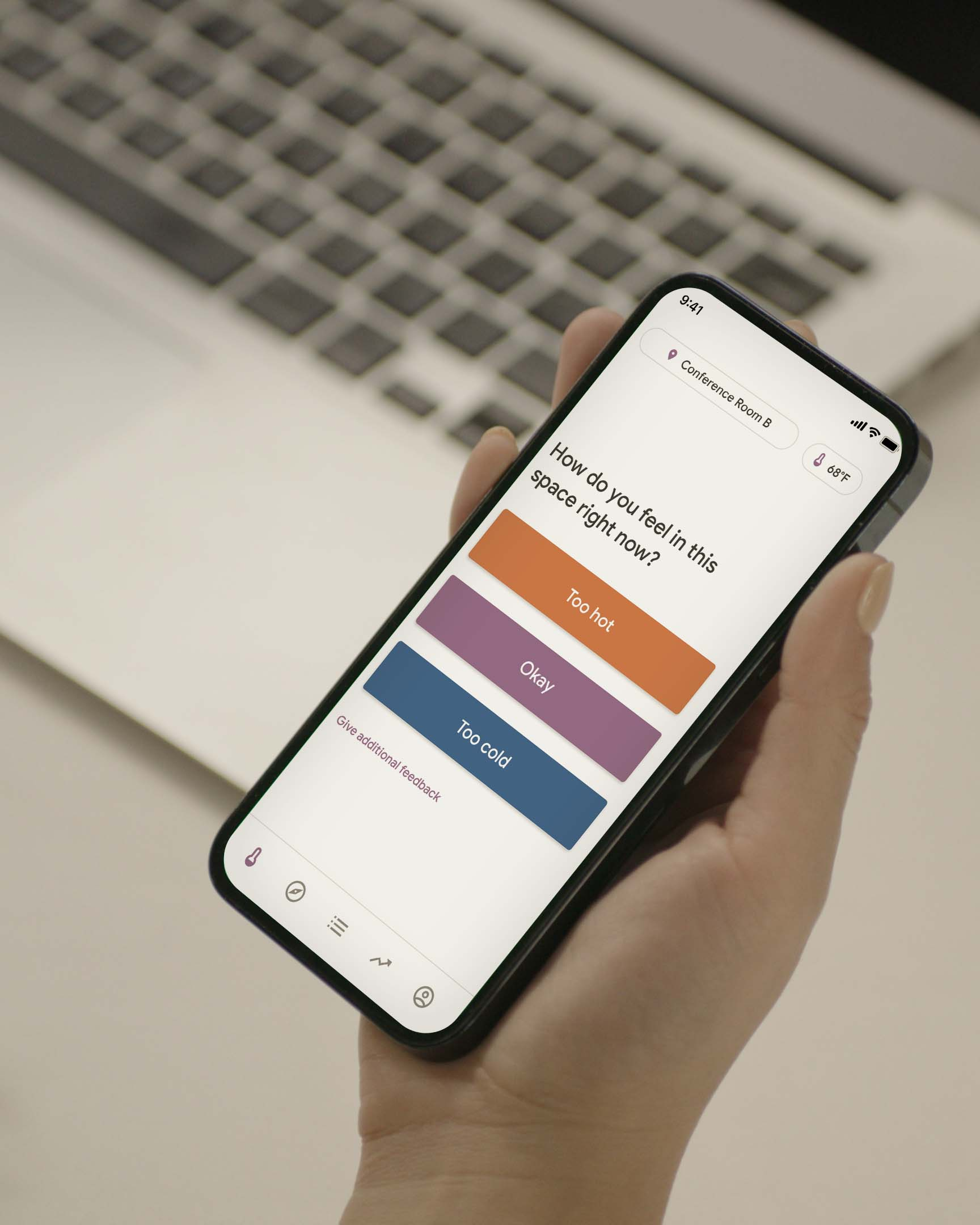 A hand holding up the Mesa tenant app
