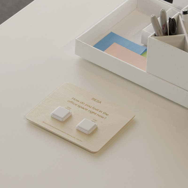 Mesa's comfort buttons displayed on an office desk