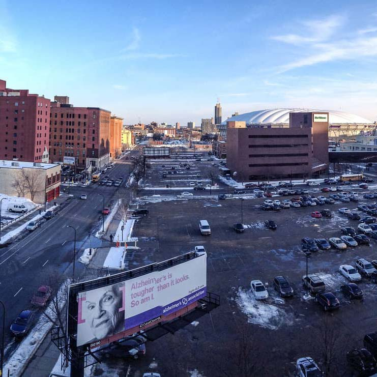 Photo of parking lots and city buildings