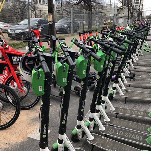 A row of electric scooters