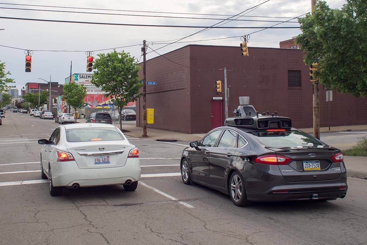 An Uber self-driving car cruises the streets of Pittsburgh