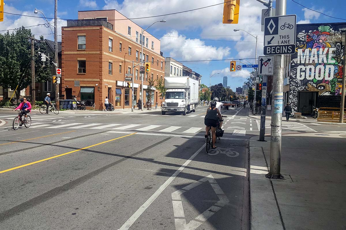 A stretch of Bloor Street in Toronto with a bike lane