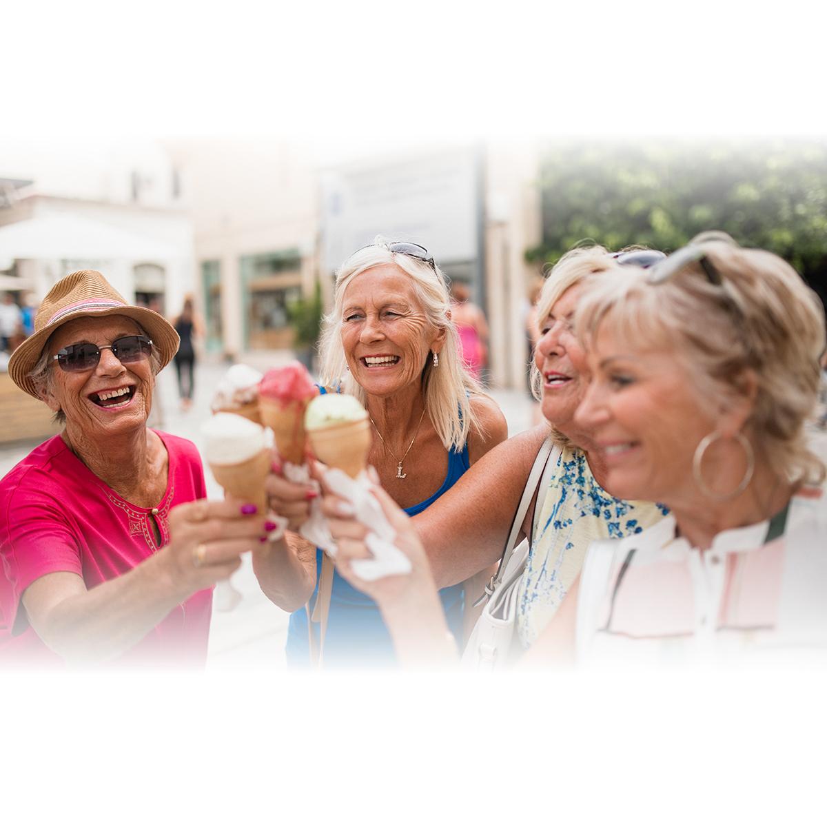senior women having ice cream
