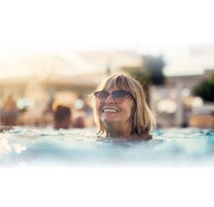 Senior woman enjoying the pool at a retirement community