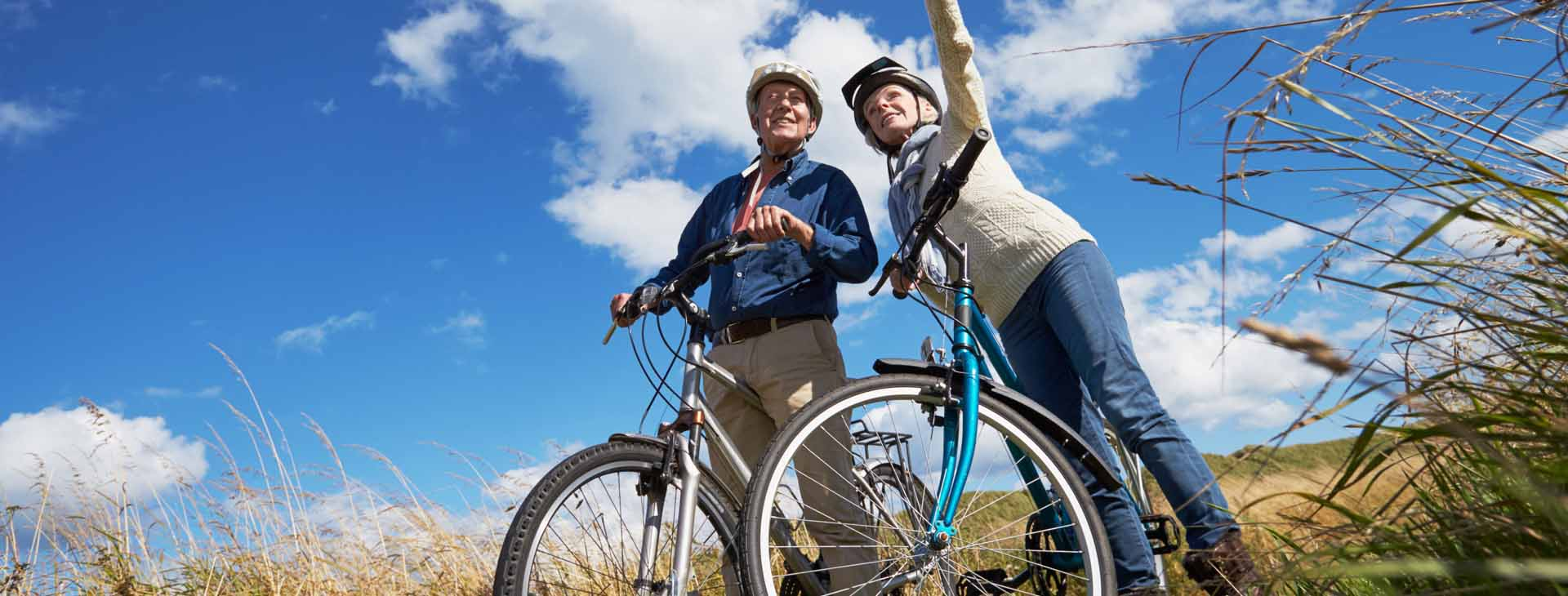 A senior couple on an outdoor bike ride