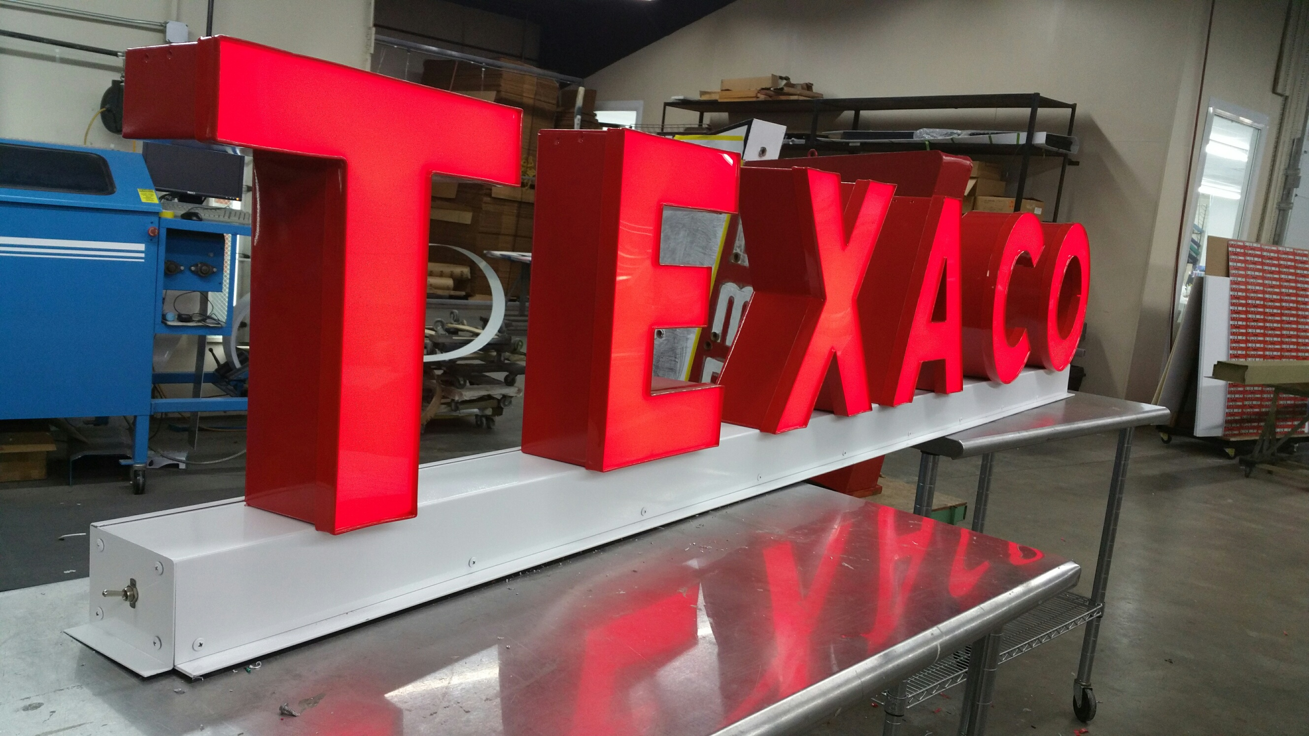 Building TEXACO channel letters sign