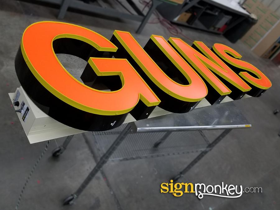 Guns Channel Letters On Raceway, Channel Letters, Channel Letters On Raceway, Orange Channel Letters On Raceway, Gun Shop Signs Gun Shop Signs, Gun Signs, Raceway Signs, Orange LED Signs, LED Sign, LED Letter Sign