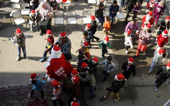 Michelle Obama explica a niños de EEUU la ruta de Santa Claus