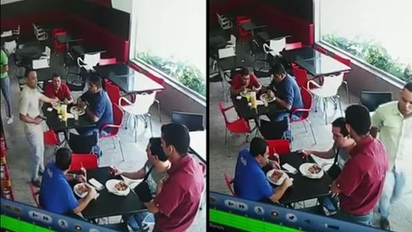 Video muestra momento en que ladrón asalta a comensales en restaurante