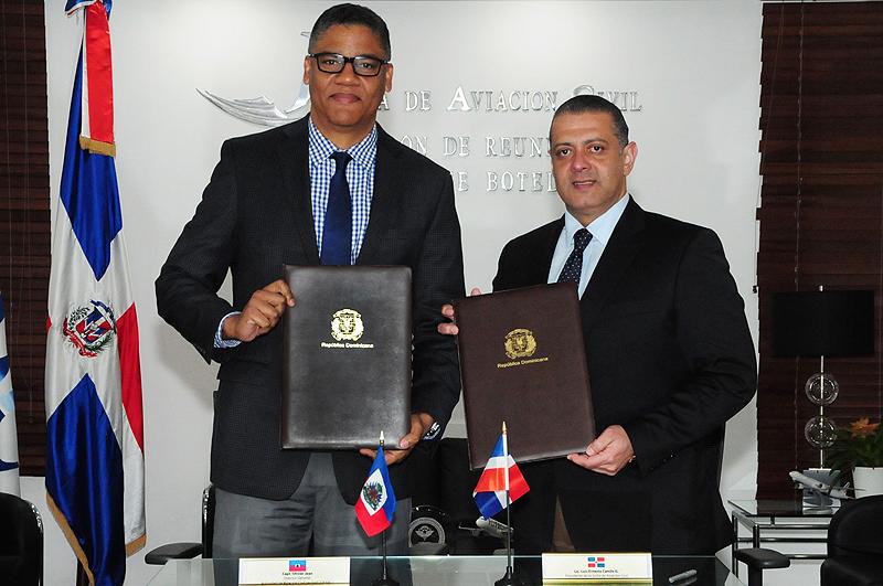RD y Haití firman acuerdos de entendimiento de servicios aéreos