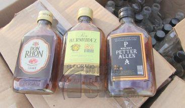 Desmantelan varios puntos de falsificación de bebidas alcohólicas en Azua