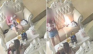 Un Samsung estalla al lado de mujer con un bebé en un salón de belleza